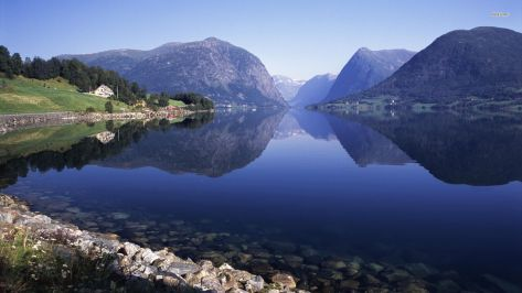 The Hardangerfjord in Norway produces as much farmed salmon as all of BC. Plus it makes a great desktop wallpaper.